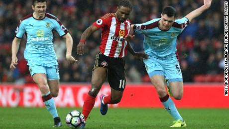 England internationals Jermain Defoe (center) and Michael Keane (right) in action during Sunderland's Premier League clash with Burnley.