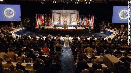 FORT LAUDERDALE, UNITED STATES:  Representatives of the member countries of the Organization of American States (OEA) listen to US President George W. Bush speak at their 35th General Assembly in Ft. Lauderdale, Florida 06 June 2005. Bush pushed for strengthening democracy and free trade as representatives of the 34 Organization of American States nations meet for their annual General Assembly.  AFP PHOTO/ Roberto Schmidt  (Photo credit should read ROBERTO SCHMIDT/AFP/Getty Images)