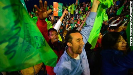 Supporters of the Ecuadorean presidential candidate of the ruling Alianza PAIS party, Lenin Moreno, celebrate although the official results of the national elections have not yet been announced, in Quito on April 2, 2017. / AFP PHOTO / RODRIGO BUENDIA        (Photo credit should read RODRIGO BUENDIA/AFP/Getty Images)