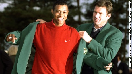 13 Apr 1997:  1996 US Masters winner Nick Faldo of Great Britain helps 1997 winner Tiger Woods of the USA put on the Green Jacket after Woods won the US Masters at Augusta, Georgia with a record low score of 18 under par. \ Mandatory Credit: Stephen Munday /Allsport