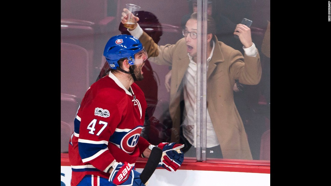 A hockey fan celebrates with Montreal's Alexander Radulov after Radulov scored against Dallas on Tuesday, March 28.