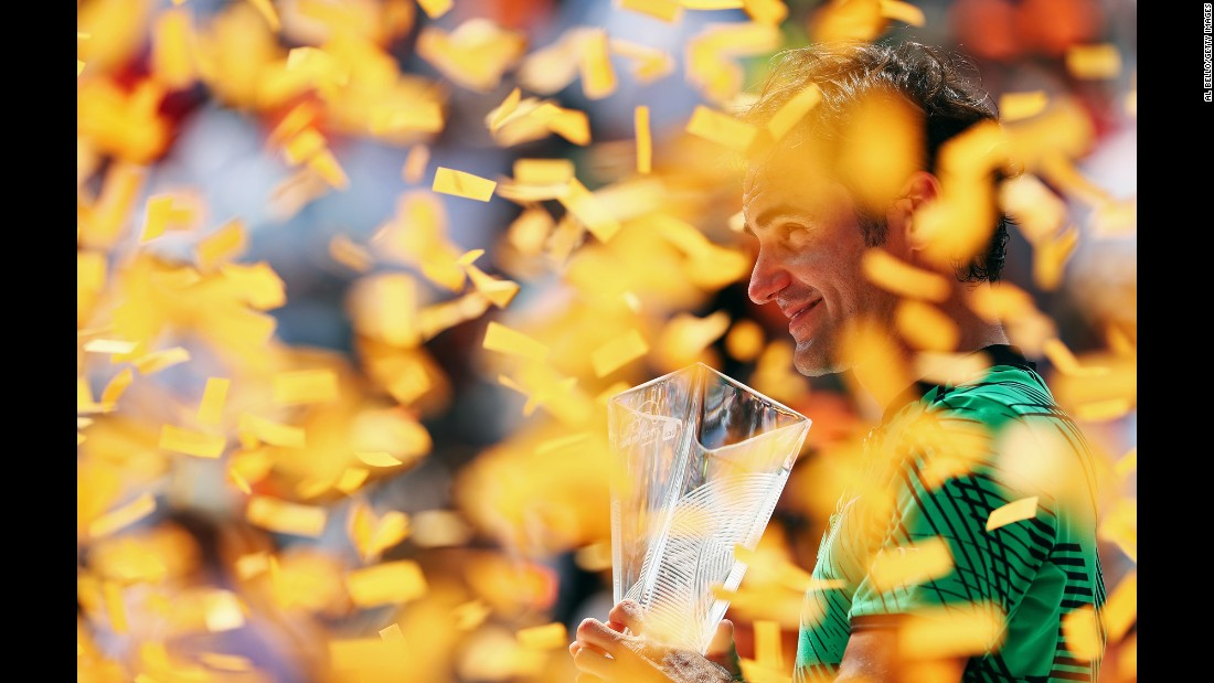 Roger Federer holds his trophy after winning the Miami Open on Sunday, April 2. Federer defeated longtime rival Rafael Nadal in the final.