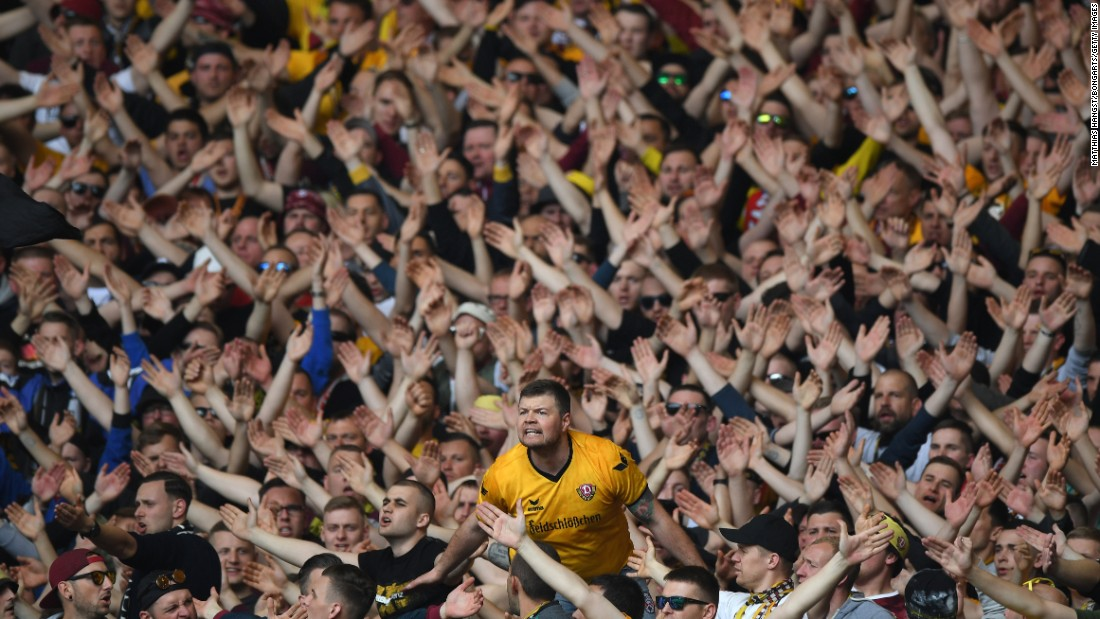 Fans of the soccer club Dynamo Dresden show their support during a German league match in Stuttgart on Sunday, April 2.