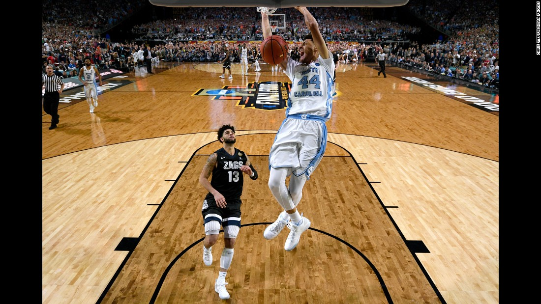 "Justin Jackson throws down a dunk to put the exclamation mark on North Carolina's 71-65 victory over Gonzaga in <a href=""http://www.cnn.com/2017/04/03/sport/gallery/march-madness-final/index.html"" target=""_blank"">the NCAA Tournament final</a> on Monday, April 3. It is North Carolina's sixth national title and first since 2009."