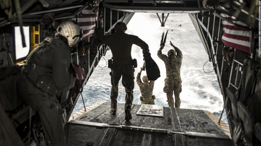 US Marines jump out of a helicopter during an exercise in the Philippine Sea on Sunday, March 19.
