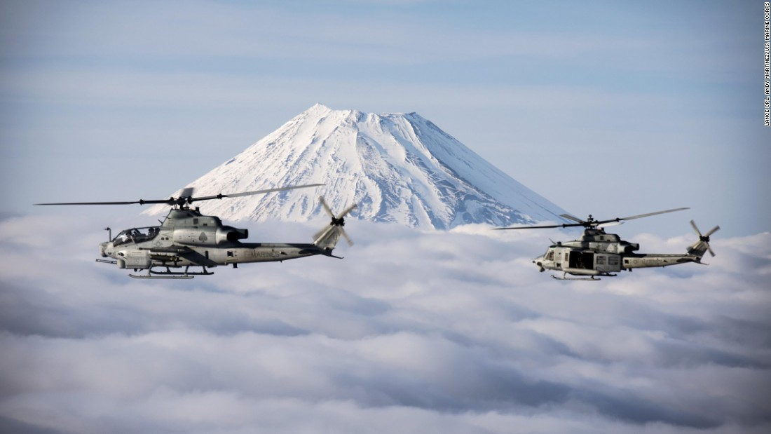 Two Marine Corps helicopters fly past Japan's Mount Fuji on Sunday, March 12.