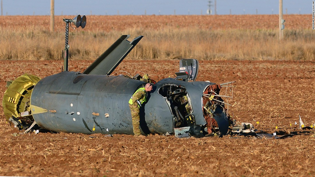 Air Force personnel inspect wreckage Wednesday, March 15, after a surveillance aircraft crashed outside of Clovis, New Mexico. Three airmen were killed in the crash, which is being investigated.