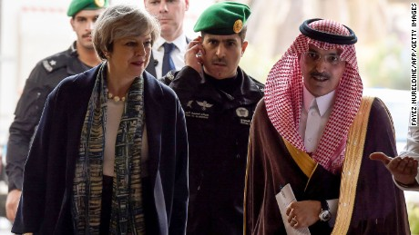 British Prime Minister Theresa May is escorted by Saudi Finance Minister Mohammed al-Jadaan at the Saudi Stock Exchange Riyadh on Tuesday.
