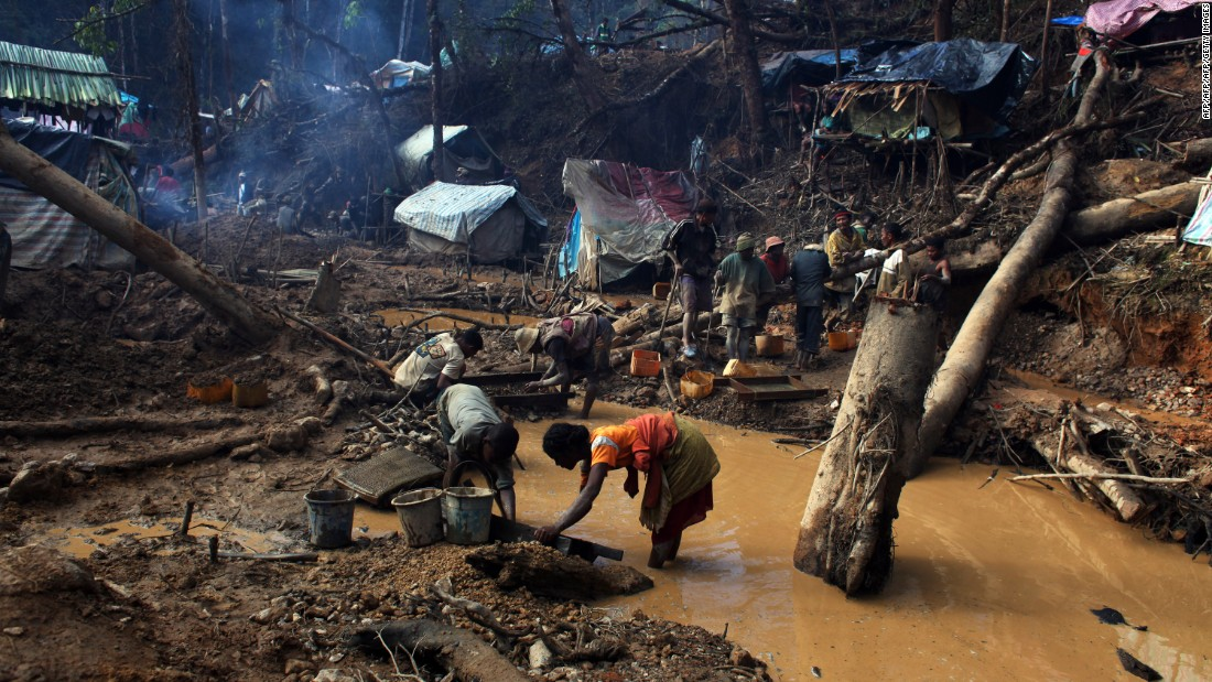 Miners at work in a sapphire mine in the region of Didy in the natural reserve Ankeniheny-Zahamena. In a country where over  70% of the population earn less than $1.90 a day, the mining industry has a powerful allure.