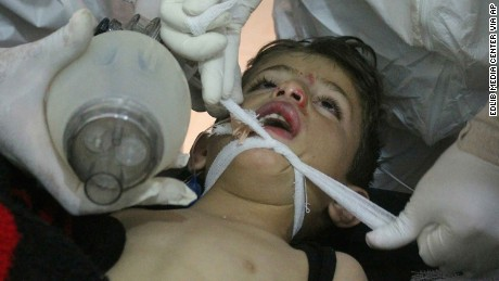 Syrian doctors treat a child following the suspected chemical attack Tuesday.
