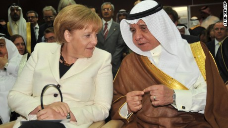 German Chancellor Angela Merkel speaks with Abdullah Alireza, minister of commerce and industry of Saudi Arabia.
