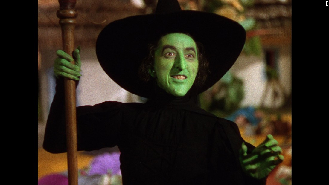 "In ""The Wizard of Oz,"" the Wicked Witch of the West, played by Margaret Hamilton, vows to take revenge on Dorothy after her house kills a fellow witch."