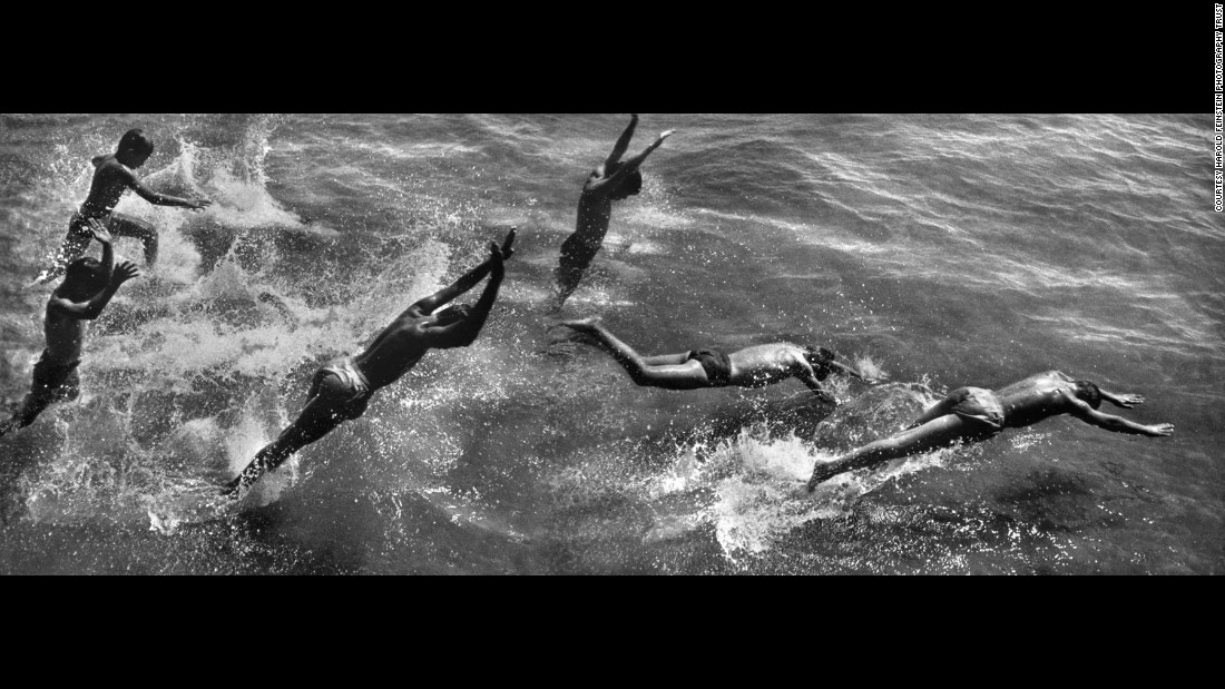 Boys dive into the ocean in this Coney Island montage, which was created in the darkroom from three negatives.