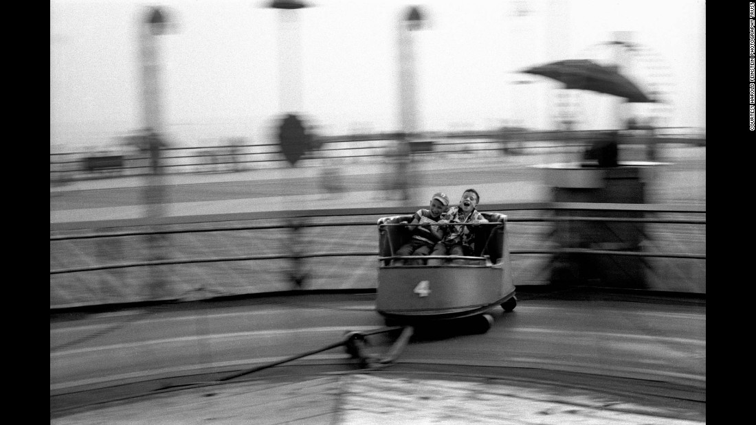 "Boys enjoy an amusement ride on Coney Island's boardwalk in 1950. The ""Contagious Optimism"" exhibition runs through the end of April at the <a href=""http://www.thierrybigaignon.com/"" target=""_blank"">Thierry Bigaignon Gallery</a> in Paris. Bigaignon will showcase Feinstein's later work in 2018 and 2019, he said."