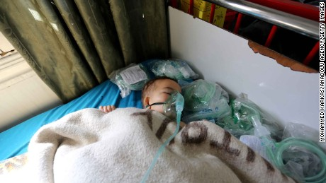 A child receives treatment Tuesday at an Idlib province hospital after a suspected chemical attack.