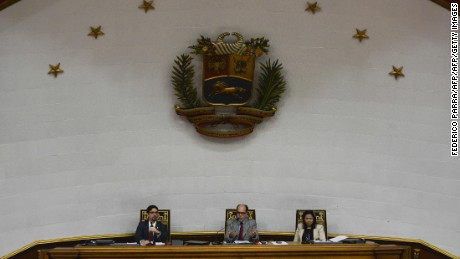 The president of the National Assembly, Julio Borges (C), the first Vice President of the chamber Freddy Guevara (L) and the second vice president of the chamber Dennis Fernandez attend a session as opposition lawmakers pass a key motion against President Nicolas Maduro in a bid to force early elections, at the Congress in Caracas on January 9, 2017. Venezuelan opposition lawmakers sought to trigger early elections by passing a key censure motion against Maduro, who is ruling over a national economic crisis and consequent food shortages. / AFP / FEDERICO PARRA        (Photo credit should read FEDERICO PARRA/AFP/Getty Images)