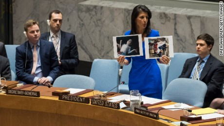 US Ambassador to the UN Nikki Haley holds up photos of victims of the Syrian chemical attack during a meeting of the Security Council.
