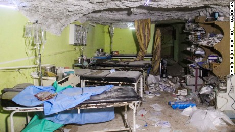 TOPSHOT - A picture taken on April 4, 2017 shows destruction at a hospital room in Khan Sheikhun, a rebel-held town in the northwestern Syrian Idlib province, following a suspected toxic gas attack.