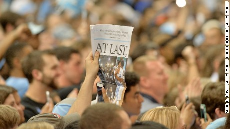 CHAPEL HILL, NC- APRIL 4:  A North Carolina Tar Heels fan holds up the local newspaper during the welcome-home reception for the NCAA men's basketball team on April 4, 2017 in Chapel Hill, North Carolina. The Tar Heels defeated the Gonzaga Bulldogs 71-65 yesterday to win the national championship.  (Photo by Sara D. Davis/Getty Images)