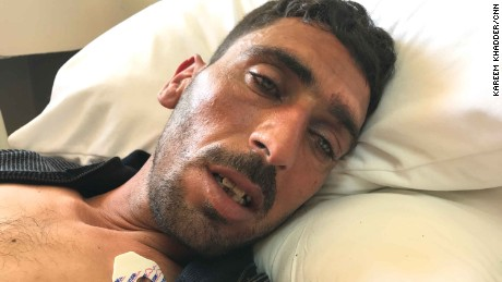 Ahmed Abdel Rahim stares vacantly from his hospital bed as he describes the attack.