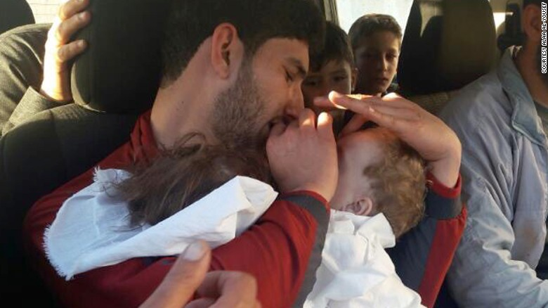 Youssef holds his twins, who were killed in Tuesday's chemical attack