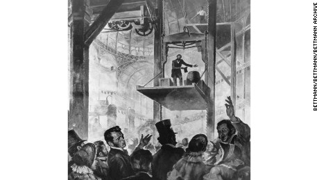 Elisha Graves Otis shows his first elevator in the Crystal Palace, New York City, 1853.