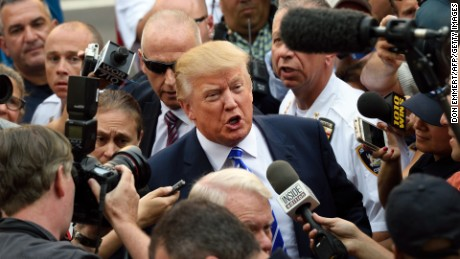 Donald Trump is surrounded by a sea of reporters as he arrives for jury duty at New York Supreme Court August 17, 2015 in New York.