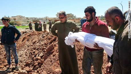 Syrians bury the bodies of victims of a a suspected toxic gas attack in Khan Sheikhun, a nearby rebel-held town in Syrias northwestern Idlib province, on April 5, 2017.