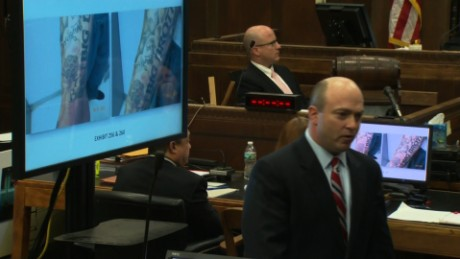 Prosecutor Patrick Haggan shows the jury Aaron Hernandez's tattoos during his double-murder trial.