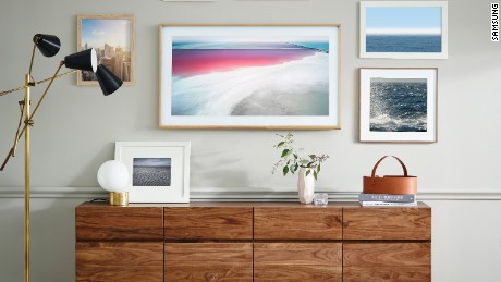 "The Frame television by Yves Béhar for Samsung switches to ""art mode"" when not in use"