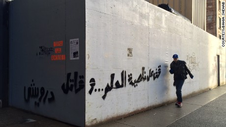 "Shehab's street art includes writings from Palestinian poet Mahmoud Darwish: ""Stand at the corner of a dream and fight"""