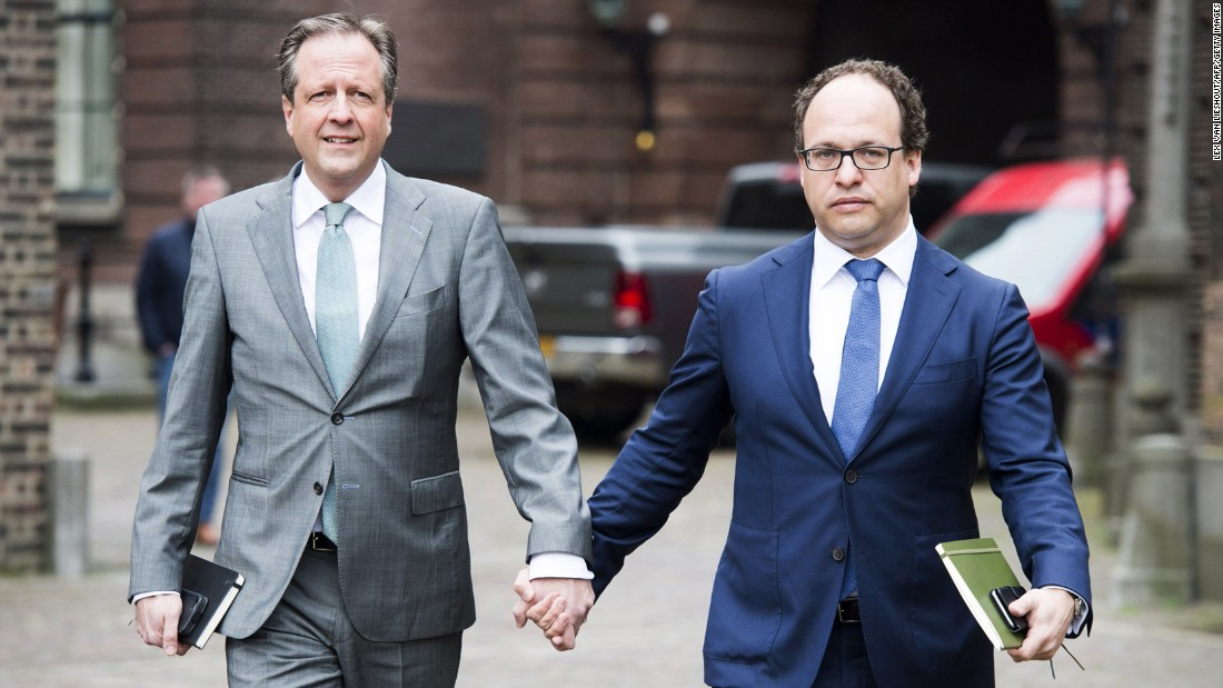 "Dutch politicians Alexander Pechtold, left, and Wouter Koolmees hold hands as they arrive for a meeting in The Hague, Netherlands, on Monday, April 3. Across the world, many Dutch citizens have been posting images of themselves on social media with the hashtag #allemannenhandinhand (all men, holding hands). <a href=""http://www.cnn.com/2017/04/05/europe/men-holding-hands-netherlands/"" target=""_blank"">The trend started</a> after reports that a gay couple was attacked in Arnhem, Netherlands."