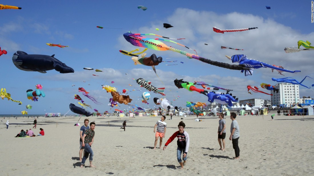 Boys play soccer on the beach as the International Kite Festival takes place in Berck, France, on Thursday, April 6.