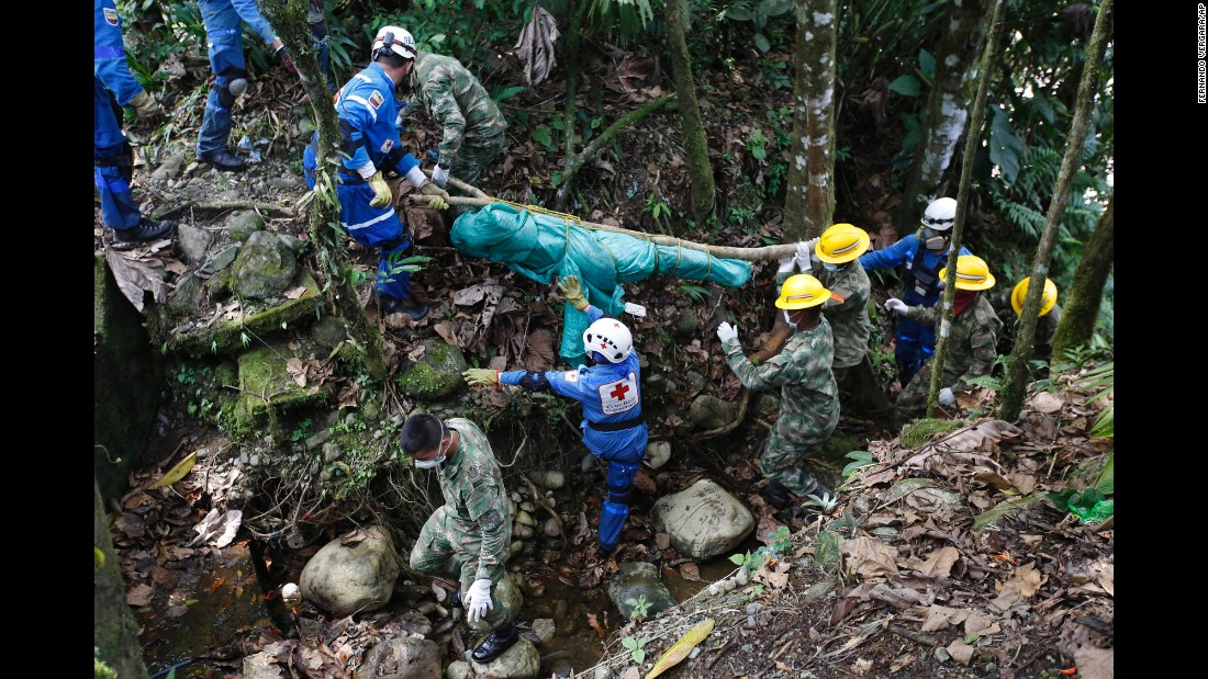 "Colombian soldiers and members of the Red Cross recover a body Monday, April 3, after <a href=""http://www.cnn.com/2017/04/02/americas/colombia-mudslide/"" target=""_blank"">a deadly mudslide</a> in Mocoa, Colombia. Torrential rains caused three rivers to overflow, sending a torrent of mud surging through the city."