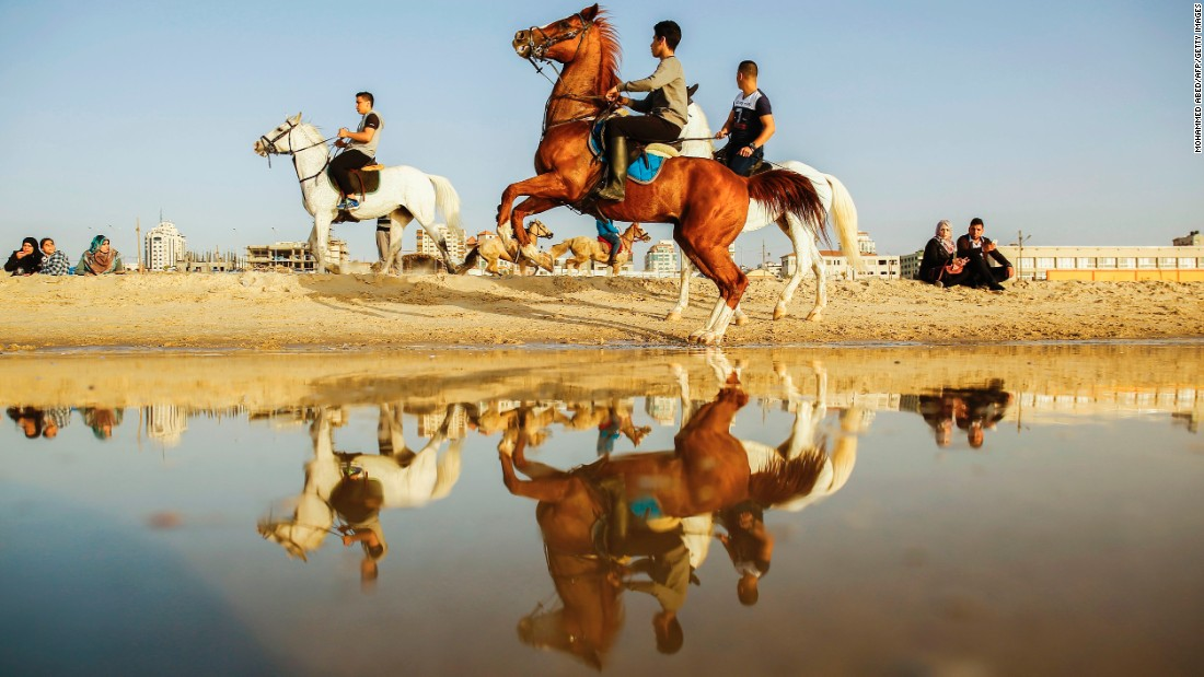 Young Palestinians ride horses in Gaza City on Friday, March 31.