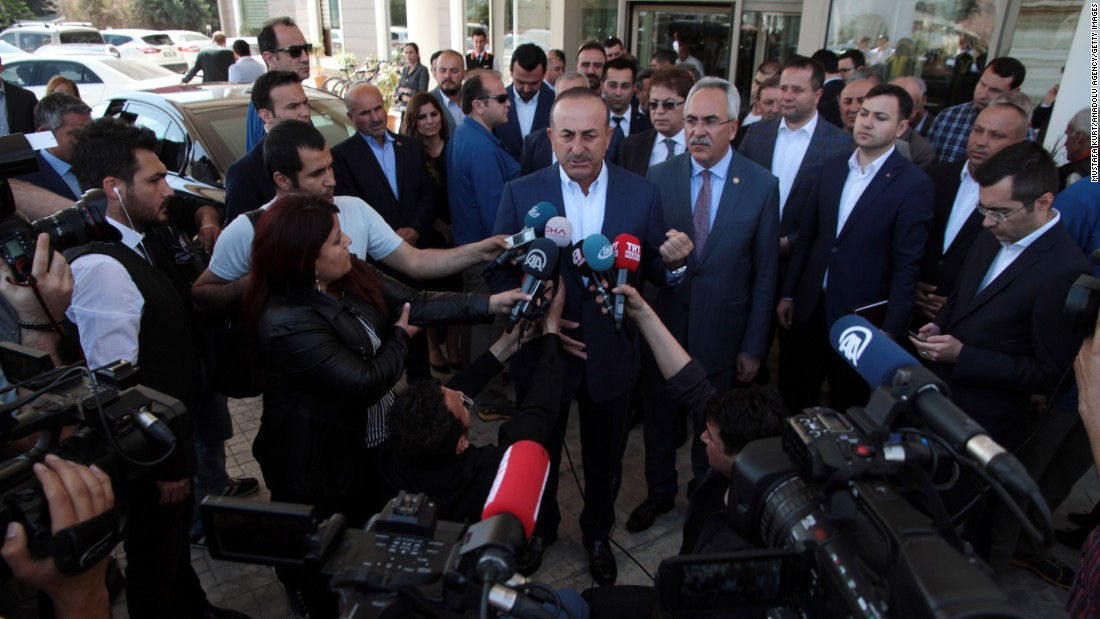 Turkish Foreign Minister Mevlut Cavusoglu speaks to the media in Antalya, Turkey. He welcomed Friday's US airstrike on Syria, according to a statement.