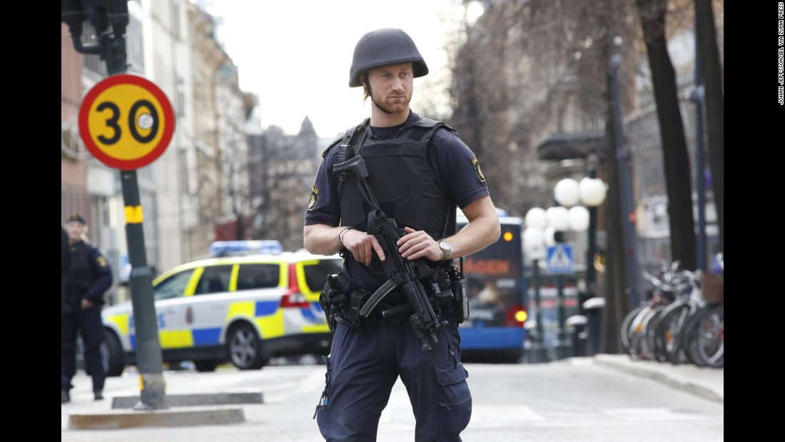 A police officer stands guard near the scene of the attack.