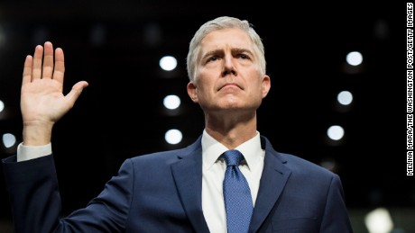 WASHINGTON, DC - President Donald Trump's nominee Judge Neil Gorsuch for the US Supreme Court is sworn in and makes his statement before the Senate Judiciary Committee on the first of day of confirmation hearings on Capitol Hill in Washington, DC Monday March 20, 2017. (Photo by Melina Mara/The Washington Post via Getty Images)