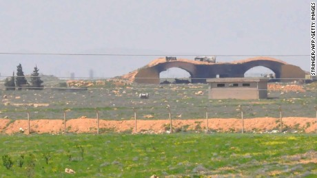 "A picture taken on April 7, 2017 shows a view of the damaged Shayrat (""ash-Shairat"") airfield at the Syrian government forces military base targeted earlier overnight by US Tomahawk cruise missiles, southeast of the central and third largest Syrian city of Homs. / AFP PHOTO / STRINGER        (Photo credit should read STRINGER/AFP/Getty Images)"