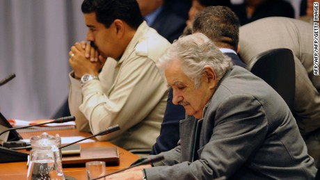 Presidents Nicolas Maduro (L) of Venezuela and Jose Mujica of Uruguay, listen during a meeting with other leftist Latin American leaders called after Bolivia's President Evo Morales plane was rerouted in Europe amid suspicions US fugitive Edward Snowden was aboard, in the Bolivian central city of Cochabamba, on July 4, 2013. Leftist Latin American leaders gathered in Cochabamba on Thursday to back President Evo Morales, fuming after some European nations temporarily refused his plane access to their airspace amid suspicions US fugitive Edward Snowden was aboard. Snowden is seeking sanctuary in several nations to evade US espionage charges.   AFP PHOTO / JORGE BERNAL        (Photo credit should read JORGE BERNAL/AFP/Getty Images)