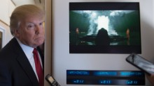 "US President Donald Trump speaks to the press on Air Force One on April 6, 2017. Chinese President Xi Jinping touched down in Florida Thursday for a first face-to-face meeting with President Donald Trump, hoping that a basket full of ""tweetable"" deals will help avoid a public clash.Trump had yet to arrive to Florida, but the pair will gather later at his Mar-a-Lago resort -- which the US president likes to call the ""Winter White House"" -- for what promises to be a masterclass in studied informality. / AFP PHOTO / JIM WATSON        (Photo credit should read JIM WATSON/AFP/Getty Images)"