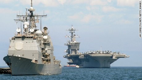 The US aircraft carrier Carl Vinson (R) was dispatched to the region.