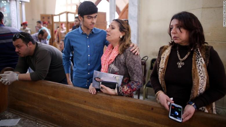 Egyptians look on in shock inside Mar Girgis church in Tanta.