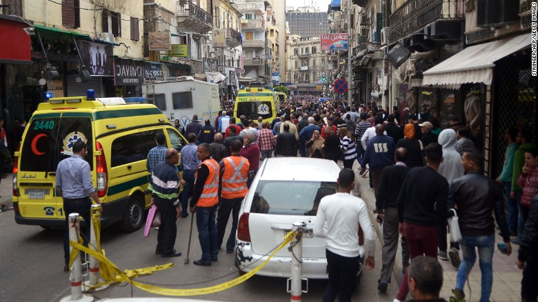 Egyptians gather near a church in Alexandria after a bomb blast struck worshipers.