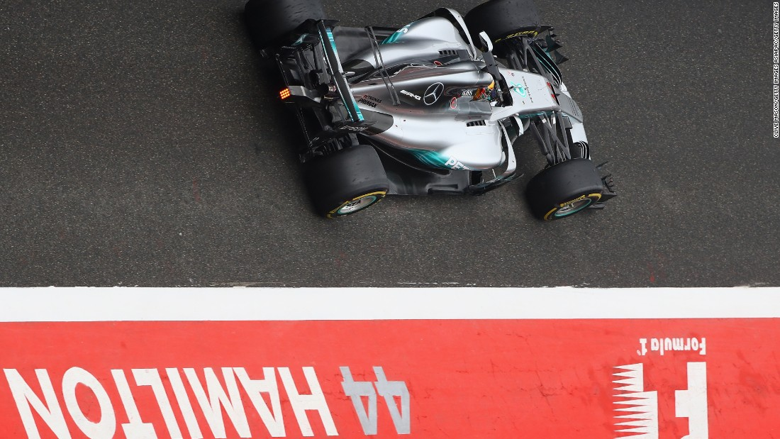 Lewis Hamilton passes through the pit lane at the Chinese Grand Prix.