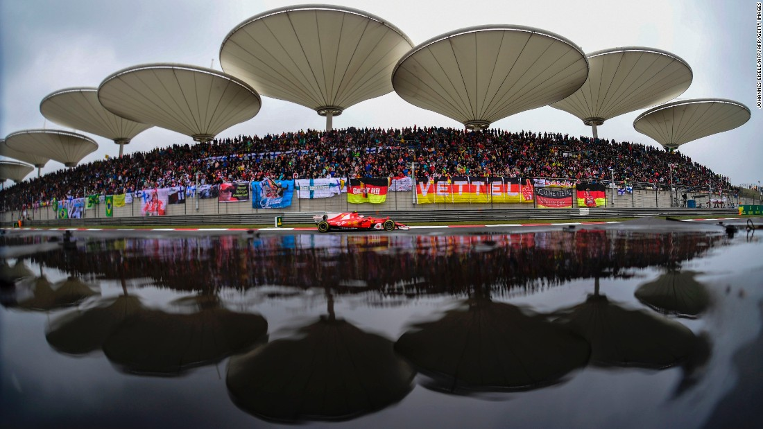 Ferrari's Finnish driver Kimi Raikkonen passes the grandstands at the Chinese Grand Prix.