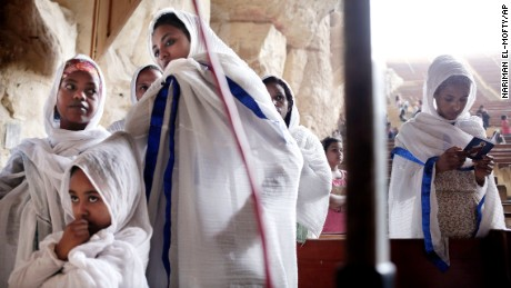 Ethiopians pray during Palm Sunday mass inside the Cave Cathedral or St. Sama'ans Church on the Mokattam hills overlooking Cairo, Egypt, Sunday, April 9, 2017. Christians in Egypt are celebrating Palm Sunday, the start of the Holy Week that leads up to Easter. (AP Photo/Nariman El-Mofty)