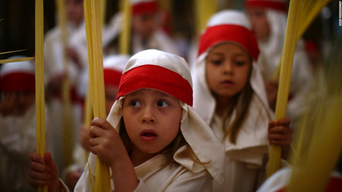Children take part in a Holy Week procession in Cordoba, Spain, on April 9.
