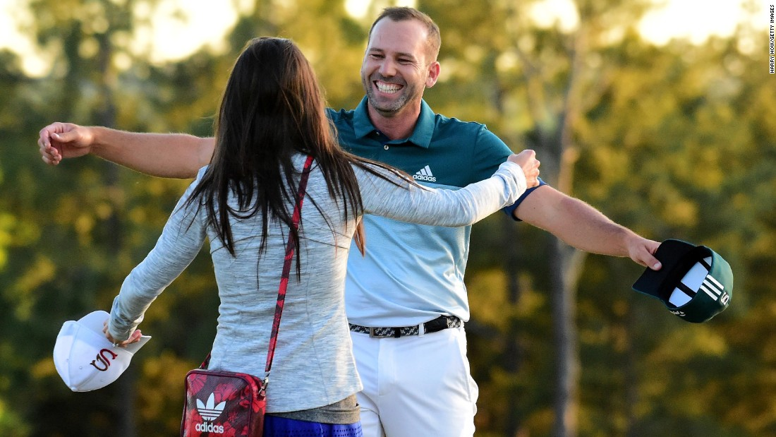Garcia embraces fiancee Angela Akins after winning his first major title in a playoff with England's Justin Rose for the Masters.