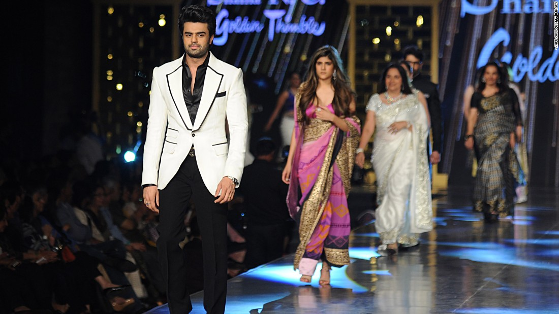 "Indian Bollywood actor Manish Paul (L) will be the host of the Dabangg show in Hong Kong on April 16. Here he is showcasing a creation by Shaina NC at the 12th annual ""Fevicol Caring with Style"" fashion show in association with the Cancer Patients Aid Association to support raising funds for cancer patients in Mumbai on February 26, 2017."